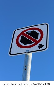 No Stopping Right of Sign Against Blue Sky