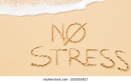No stress concept written on the sand of an exotic beach