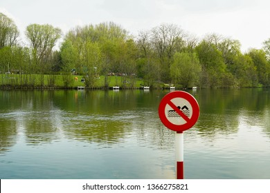 No swimming allowed sign. Please don't swim on the lake warning sign. Red indication informing to not swim.