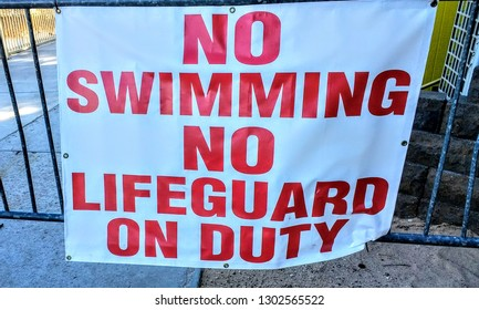 No Swimming No Lifeguard on Duty sign
