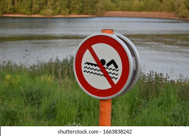 No Swimming sign by the lake without explanation