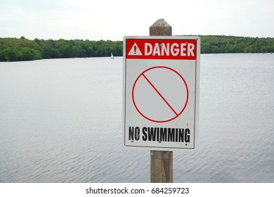 no swimming sign in front of lake