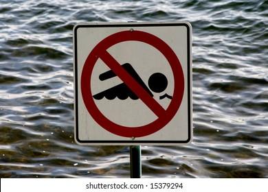 No Swimming Sign set against the waves of Lake Washington near Seattle.