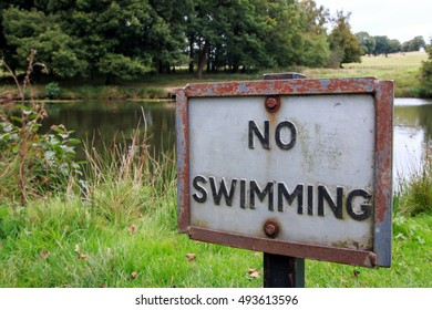 No Swimming Sign with small pond in the background