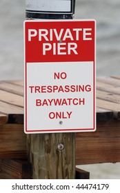 No trespassing baywatch only sign on pier