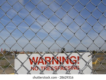 No trespassing sign and a chain link fence.