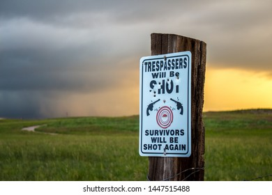 METAL SIGN WARNING VIOLATORS WILL BE SHOT WITH BULLET HOLES NO TRESPASSING