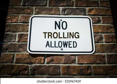 No Trolling Allowed Sign on a Brick Wall