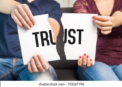 No trust. Cheating, infidelity, marital problems, having an affair and another partner, betrayal, mistrust or being unfaithful concept. Couple, man and woman, ripping same paper.