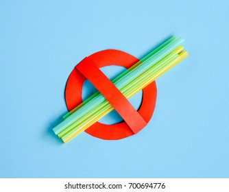 No use symbol in red with plastic straws and fork.  Plastic pollution is harmful to  marine lives. Environmental concept. Ban single use plastic.