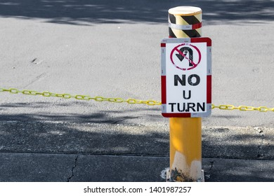 No U-Turn sign on a post in daylight