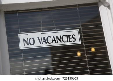 No Vacancies Hotal Sign on Window