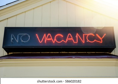 No Vacancy retro neon sign on an American motel with lens flare