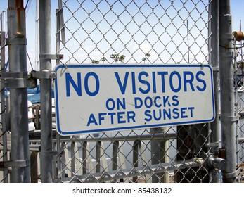 no visitors on docks after sunset sign