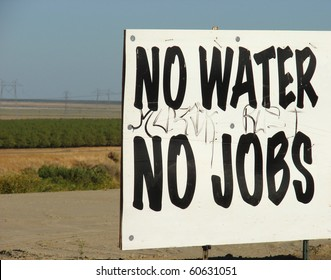 No water no jobs sign with farmland in background