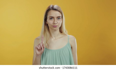 No way. It is not allowed. Young caucasian woman saying no rejecting shaking her finger negatively looking serious at camera isolated. Warning, prohibition concept.