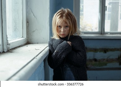No way out. Ill fated  poor depressed girl folding her hands and standing her window while feeling sad