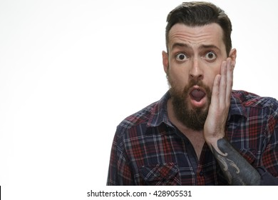 No way! Portrait of a surprised bearded man looking to the camera copyspace on the side isolated on white.