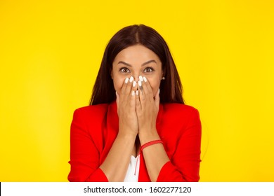 No way, wow. Closeup portrait of a beautiful woman ecstatic hands on mouth, excited happy girl. Mixed race model isolated on yellow background with copy space. Horizontal image. Natural, no makeup.