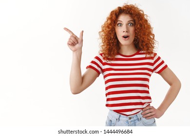 No way wow have you heard. Impressed fascinated good-looking redhead stylish girl drop jaw gasping amused smiling delighted wide eyes thrilled pointing upper left corner astonished, white background