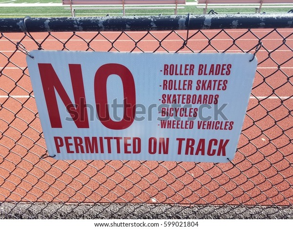 no wheels permitted on track sign