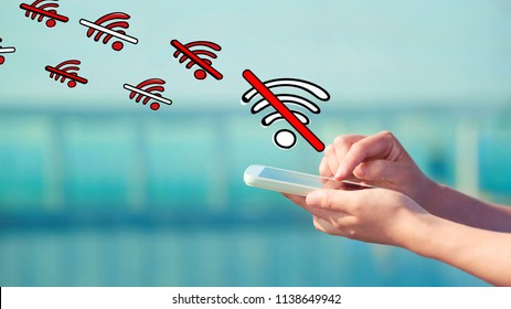 No WiFi theme with person holding a white smartphone