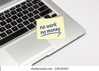 """no work no money"" written on sticky note, on laptop keyboard."