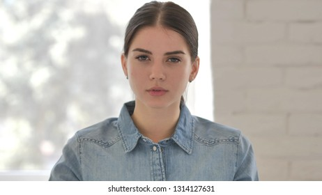 No, Young Girl Rejecting Offer by Shaking Head