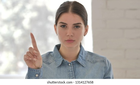 No, Young Girl Rejecting Offer by Waving Finger