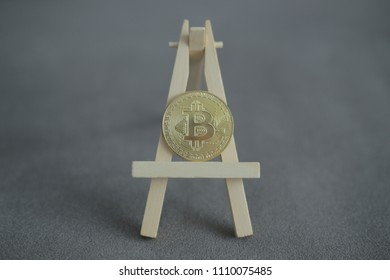 No1 crypto currency Gold Bitcoin on a rack. BTC golden coin as symbol of electronic virtual money for web banking and international network payment.  Closeup, Macro. ( Ungraded, cinestyle )