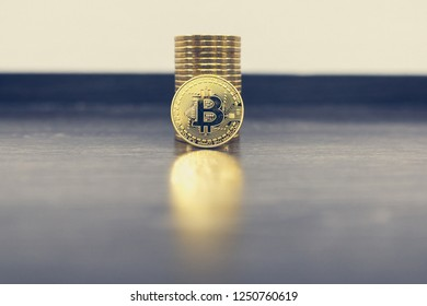No1 crypto currency Gold Bitcoin on table. BTC golden coin as symbol of electronic virtual money for web banking and international network payment.