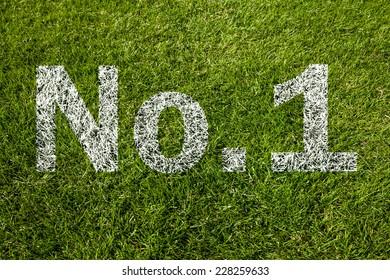 no.1 written on green grass
