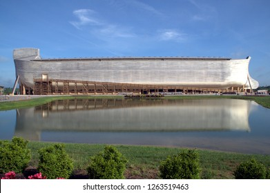 Noah's Ark Replica at Ark Encounter, side view under a clear blue sky with reflection in the water of giant wooden boat ship, Williamstown, KY, May 29, 2017