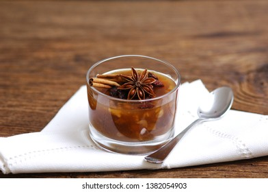 Noah's pudding, ashura, asure in a glass bowl, decorated with star anise and cinnamon sticks, white napkin