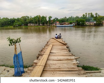 Noapara, Abhaynagar, Jashore, Bhairav River : June 06, 2019 : Riverbank of bhairav rivar of Bangladesh, Natural scenery, Beautiful sky and water of river, People usually sits on riverbank