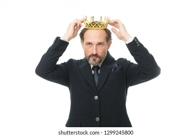 Nobility obliges. Business king. Mature businessman wearing crown. Senior man representing power and triumph. Success in business. King of style. Achieving victory and success. Fit for a king.