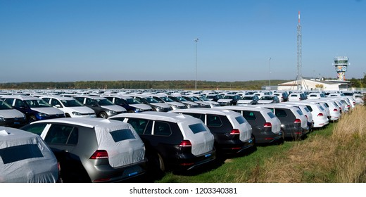 Nobitz / Germany - October 2018: Hundreds of new VW Golf vehicles, which were produced in Mosel, are temporarily parked on the apron of the Leipzig-Altenburg airport due to lack of WLTP approvals