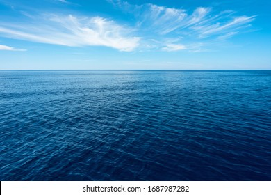 nobody in blue sea with horizon under blue sky in Greece