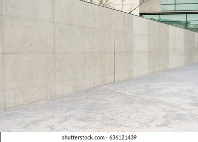 nobody photo of outdoor empty gray concrete wall at reflection windows modern building office outside in prosperous city with sidewalks background.