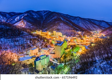 Noboribetsu, Japan hot springs town winter skyline.