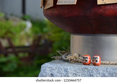 NOBORIBETSU, JAPAN - MAY 27,2015: The Japanese daruma doll on the way in the forest area of Noboribetsu onsen village, Hokkaido