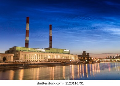 Noctilucent clouds in Moscow. Building and pipes of the combined heat and power plant.