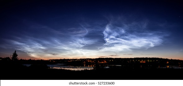 Noctilucent clouds at night sky