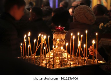 nocturnal christmas service in a russian orthodox church, close-up of burning candles