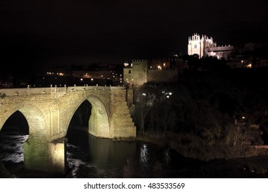 nocturnal landscapes of Toledo in San Martin bridge,View of the medieval bridge  on the Tagus River as it passes through Toledo, Spain,