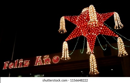 A nocturnal urban decoration of a giant piñata for Christmas and New Year celebrations in Mexico. A piñata is it is typical of the Mexican Christmas celebration.
