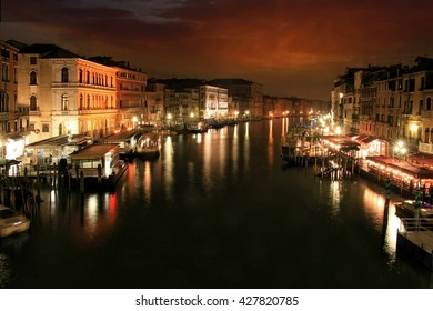 Nocturne scene with light trails of boats along the Grand Canal of Venice