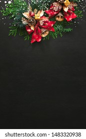 """Noel or Christmas greeting card concept with copy space for greetings or advertising text, view from above on traditional X-mass decorations lying down moody dark surface decorated with """"snow"""""""