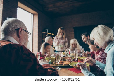 Noel evening family gathering, meeting. Grey-haired grandparents, grandchildren, daughter, son, brother, sister, relatives sitting at table, house fun joy party, eating tasty yummy food