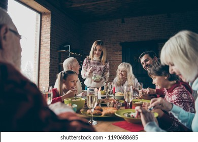 Noel evening, night family gathering, meeting. Cheerful grey-haired grandparents, grandchildren, brother, sister, relatives sitting at table, house fun joy party, feast, eating tasty yummy food